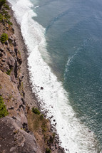Aerial view of the ocean shoreline and waves,