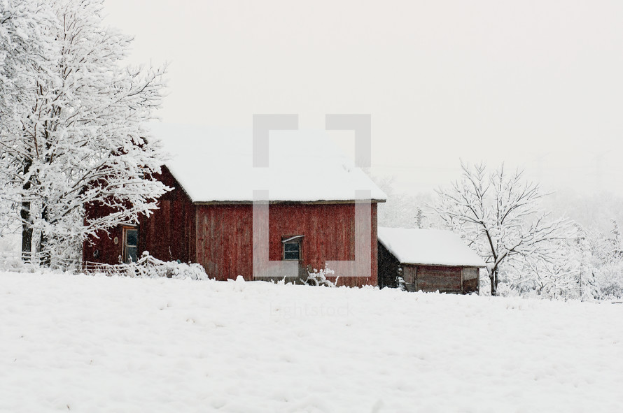 a barn covered in snow