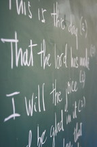 Scripture written on chalkboard