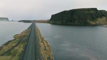 road on a land bridge across a waterway