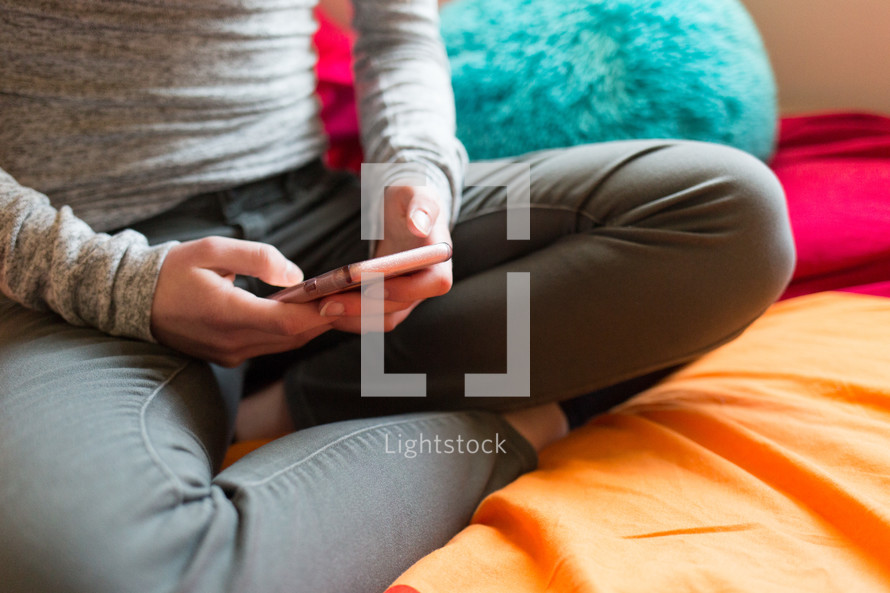 a teen girl looking at her cellphone