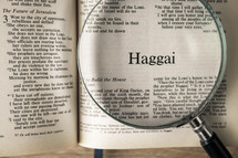 magnifying glass over Bible - Haggai