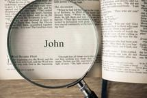 John under a magnifying glass