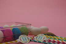 Easter eggs in a carton and paper straws