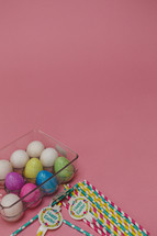 Easters eggs in a carton and paper straws