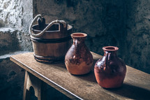 wooden bucket and pottery jugs