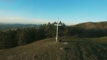 white cross on a mountaintop
