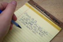 Psalm 118:28 being written on a notepad.