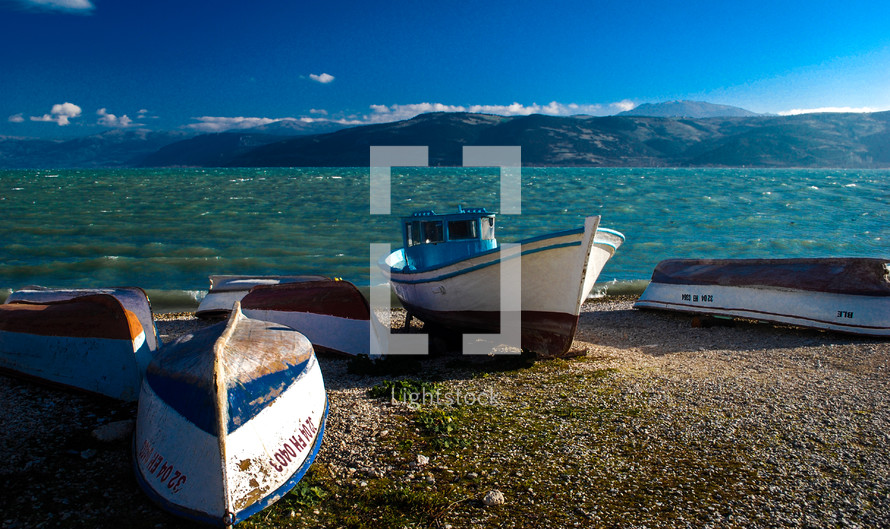 boats beached on the shore