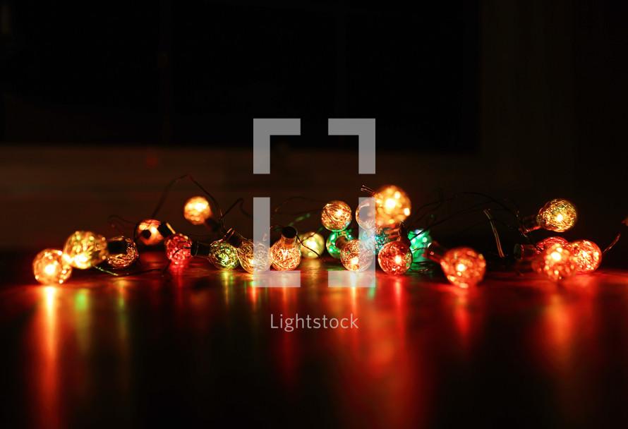 coloured Christmas lights on table