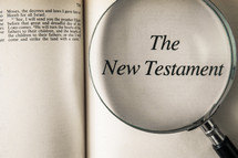 magnifying glass over Bible -The New Testament