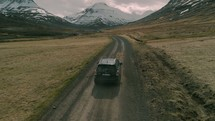 SUV traveling on a dirt road