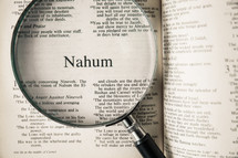 magnifying glass over Bible - Nahum