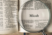 magnifying glass over Bible - Micah