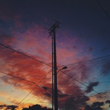 Power lines and pink clouds at sunset