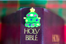 Bible with a Christmas tree eraser