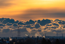 smoke stacks in the clouds