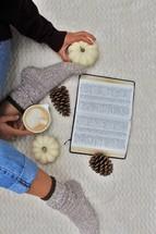 a woman in socks reading a Bible