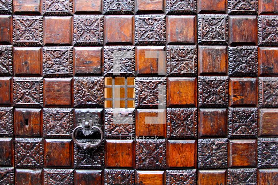 door pull on an ornate wood door