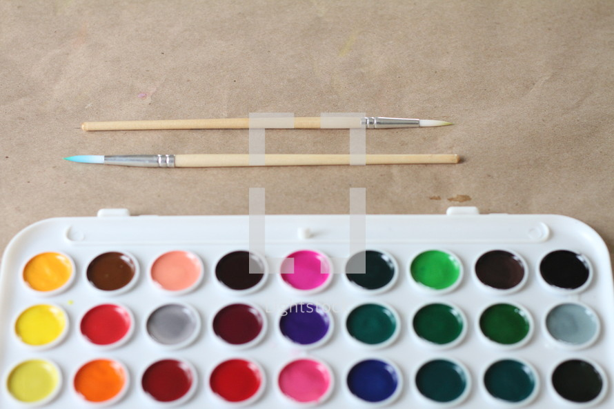 paint brushes and watercolors