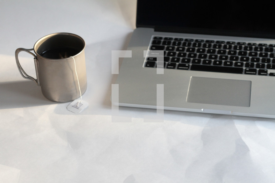 mug of hot tea and computer