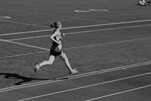 young woman running track