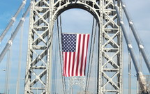 American Flag on a bridge