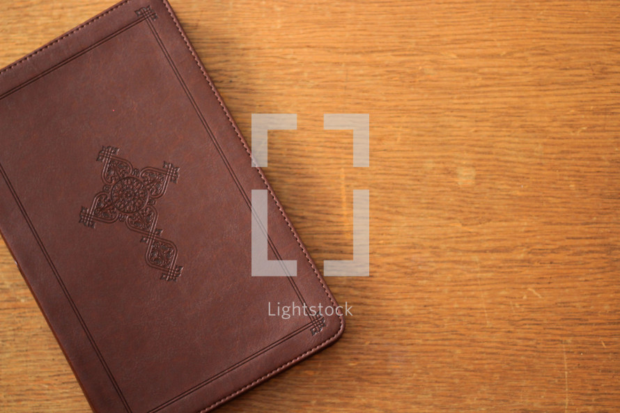 A leather Bible with a cross branded on the cover