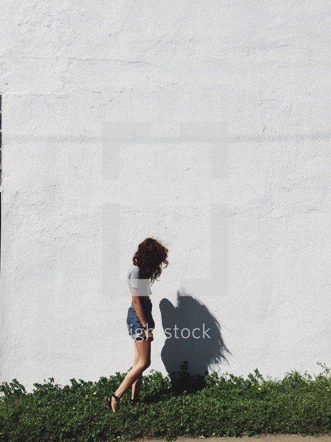 side profile and shadow of a woman outdoors
