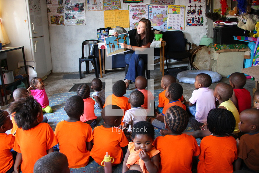 young woman teaching young children about Christ