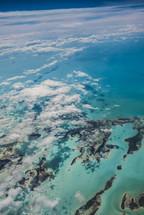 aerial view over islands below