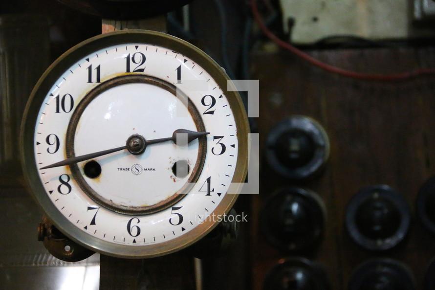 Antique wind up clock with ceramic face