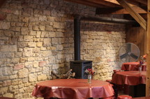 wood stove and tables in a restaurant