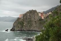 seaside European village on rocky cliffs