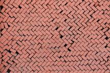 Loose brick wall in herring bone pattern
