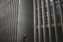 a man standing between buildings