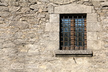 Barred window on castle wall