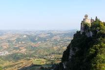 town in a valley and fortress on a mountainside in San Marino