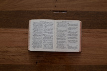 """The Christian Life"" book on a wooden table, open to the ""Repentance and Forgiveness"" chapter."
