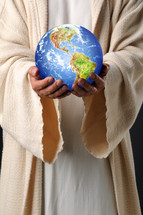 Jesus holding the world in his hands.