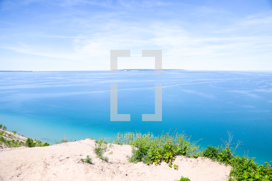 sand dunes and calm blue sea