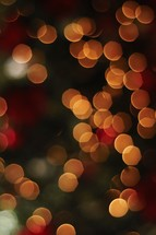 A dark Christmas bokeh background.