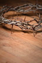 crown of thorns on a wood table