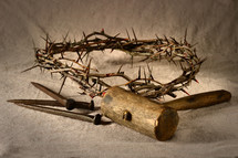 crown of thorns, mallet, and nails