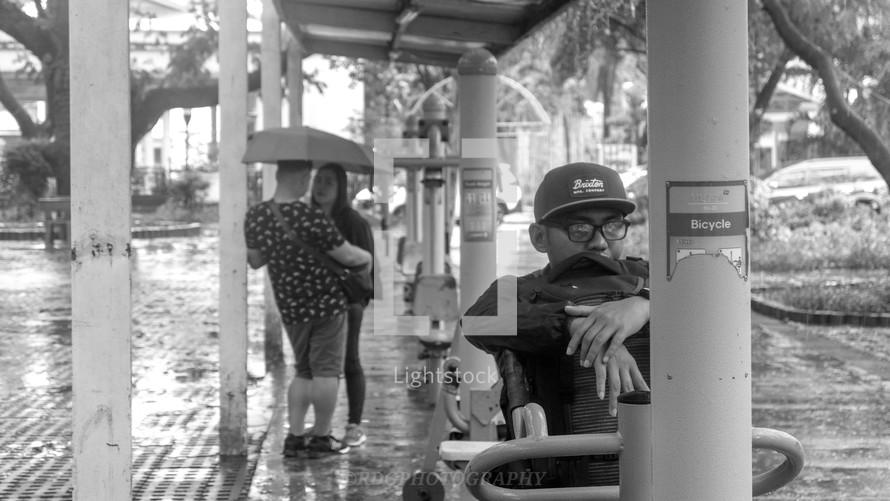 couple standing under an umbrella talking