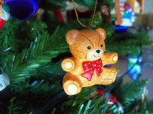 A close-up view of a Teddy Bear Christmas Tree ornament decoration adorning a Christmas Tree for the Christmas Holiday celebration for children and family.