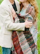 torso of a couple hugging