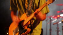 The mastery of a ska guitarist playing his electric guitar and jumping at live music concert
