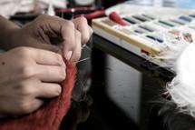 a seamstress sewing