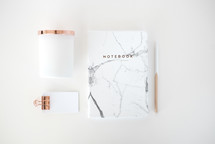 copper and white, notebook, pencil, and notepad on white background